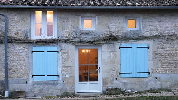 pale blue shutters on french cottage