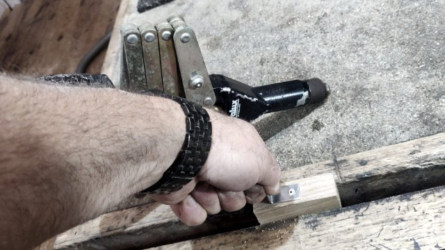 bracket pop riveted to wood